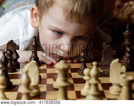 Pieces On A Chessboard.the Boy Chess Player Considers A Move