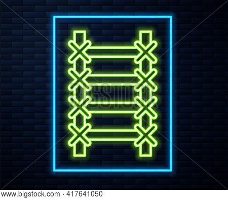Glowing Neon Line Fire Escape Icon Isolated On Brick Wall Background. Pompier Ladder. Fireman Scalin
