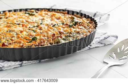 Close Up Of A Freshly Baked Quiche Ready For Serving.