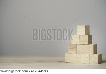 Stacking Blank Wooden Cubes On Table With Copy Space For Input Wording And Infographic Icon.