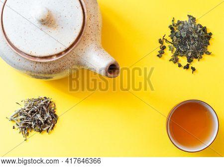 Freshly Brewed Green Tea In Cup.  Healthy Drinks Detox Antioxidants Concept. Minimalist Flat Lay Wit