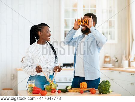 Positive Young Black Spouses Having Fun While Cooking In Kitchen At Home