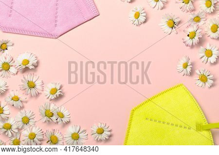 Creative Flat Lay With Daisy Flowers And Pink Fpp2 Or Kn95 Mask