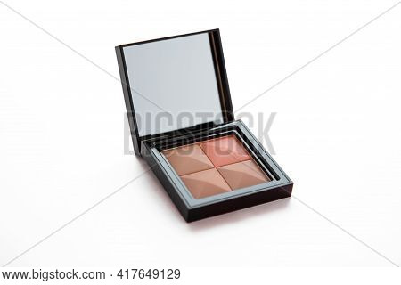 Isolated Four Colors Female Compact Face Powder With Mirror Close Up On White Background, Cosmetics