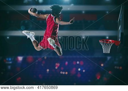Basketball Game With A High Jump Player To Make A Slam Dunk To The Basket