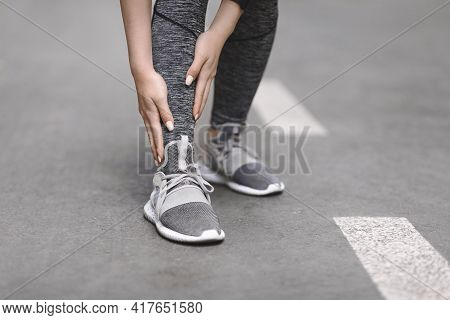 Shin Splints. Female Jogger Suffering From Sport Trauma While Running Outdoors