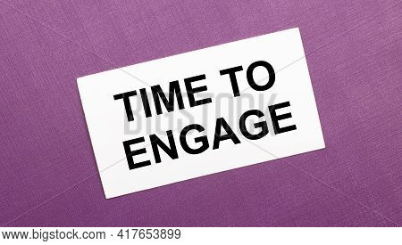 On A Lilac Background, A White Card With The Words Time To Engage