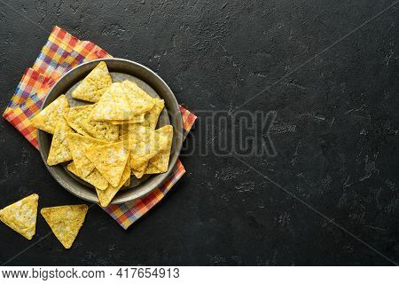 Nachos. Traditional Latinamerican Mexican Corn Chips With Guacamole Dip Sauce In A Black Bowl With A
