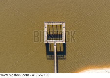 An aerial view of a fishing pier on Mobile Bay