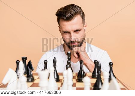 Portrait Of Nice Minded Guy Playing Chess Overthinking Deciding Next Move Isolated Over Beige Pastel