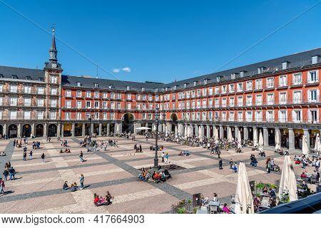 Madrid, Spain - April, 18 2021: People Enjoying In Restaurant Terraces In Plaza Mayor Square In Madr