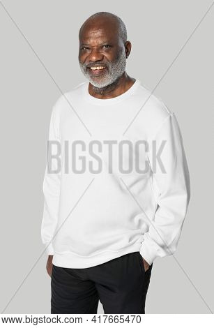 Man in white sweater casual apparel with design space close up