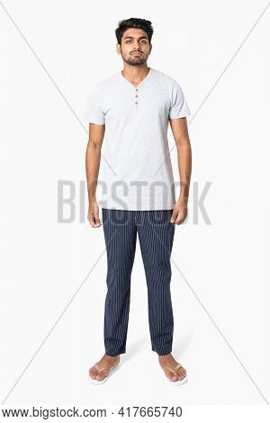Man in white t-shirt and pants sleepwear apparel