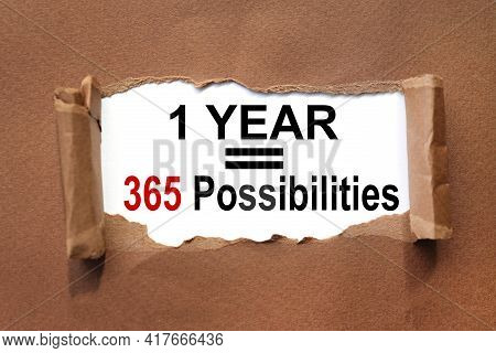 1 Year 365 Possibilities. Text Inside Torn Brown Paper. White Sheet With Black Font