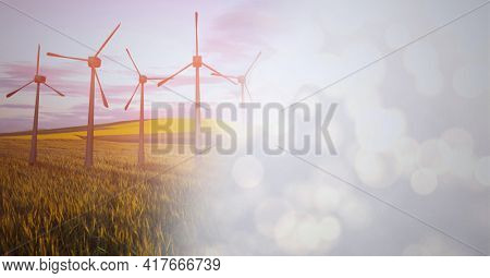 Composition of wind turbines in countryside with screen of smoke. global environment, sustainability, global warming and climate change concept digitally generated image.