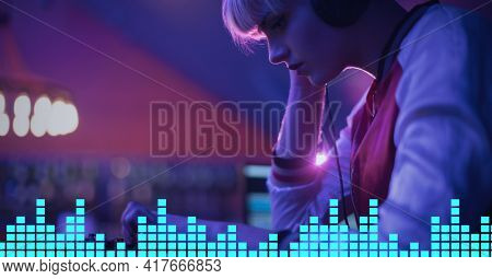 Composition on graphic music equalizer over female dj playing music in club. entertainment, music and clubbing concept digitally generated image.