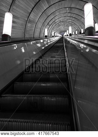 An Empty And Very Long Escalator In The Subway.