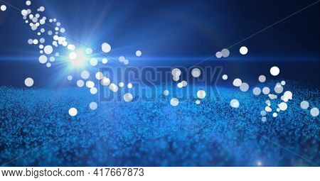 Composition of multiple white spots over glowing spot and blue mesh. global networking and digital interface concept digitally generated image.