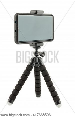 Black Cellphone In Rugged Rubber Protective Cover On Small Flexible Tripod Isolated On White