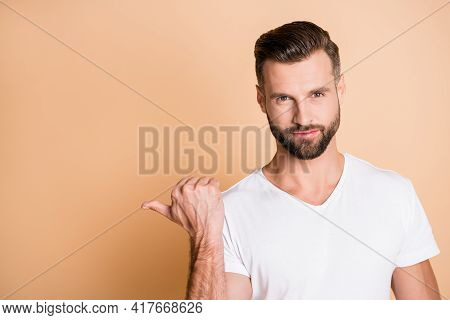 Photo Of Young Handsome Man Show Point Thumb Empty Space Promo Advert Choice Recommend Isolated Over