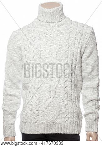 Heather grey knitted longsleeve polo neck sweater of traditional design with geometric ornament on male mannequin isolated on a white background