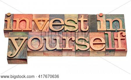 invest in yourself - isolated word abstract in vintage letterpress wood type, self improvement and personal development concept