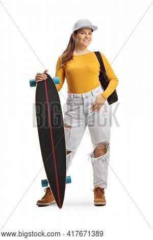 Full length portrait of a trendy young girl with a longboard isolated on white background
