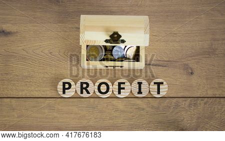 Profit Symbol. Concept Word Profit On Wooden Cubes On A Beautiful Wooden Background, Small Wooden Ch