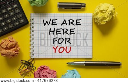Help And Support Symbol. White Note With Words 'we Are Here For You' On Beautiful Yellow Background,