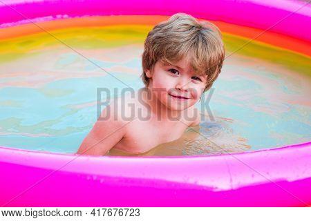 Kids Beach Fun. Kids Learn To Swim. Child Swimming Pool. Happy Little Boy Playing In Swimming Pool O