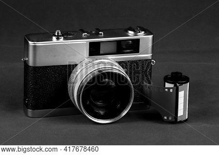 Monochrome Vintage Film Rangefinder Camera With Roll Of Film
