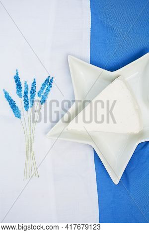Brie Cheese In A Plate On A Blue Tablecloth.