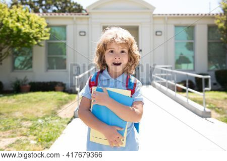 Portrait Of The Amazed American Boy Who Is Going To School With His School Backpack. Back To School.