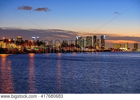 Miami City Night. City Of Miami, Night Panorama Of Downtown Business Skyscrapers.