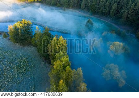 Early Morning Above Misty River And Forest. Aerial View Of Spring Landscape Of Forest And River. Col