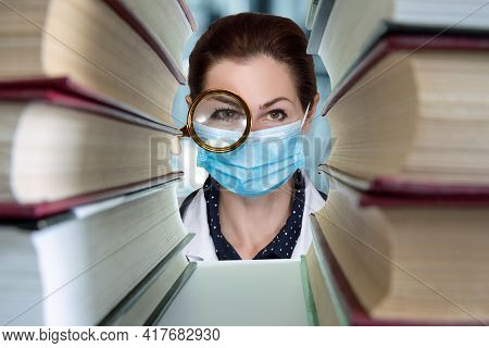 Concept Medical Learning Research And Search For Truth. Doctor Looking Through A Magnifying Glass In