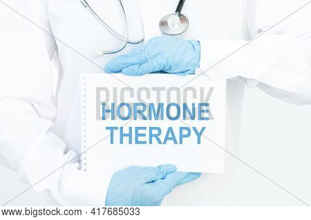 Doctor Keeps A Card With The Name Of The Diagnosis Hormone Therapy. Selective Focus. Medical Concept