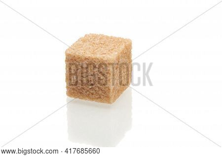 Brown Cube Of Cane Sugar Isolated On White Background. Close Up View.
