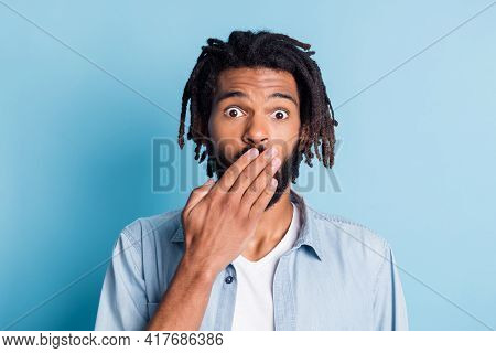 Close-up Portrait Of Nice Funny Puzzled Guy Closing Mouth Oops Isolated Over Vibrant Blue Color Back