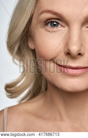 Face Close Up Portrait Of Happy Smiling Mid Age 50 Years Old Woman Isolated On White Background. Adv