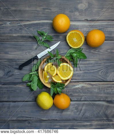 Citrus Fruits And Mint On A Cutting Board. Fresh Summer Citrus Lemonade With Lime, Mint, Oranges And