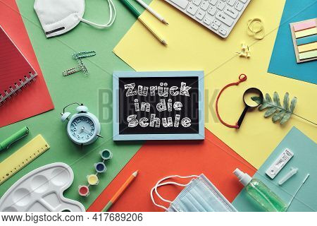 Zuruch In Die Schule Means Or Back To School In German Language. Concept Top View With Chalk Text On