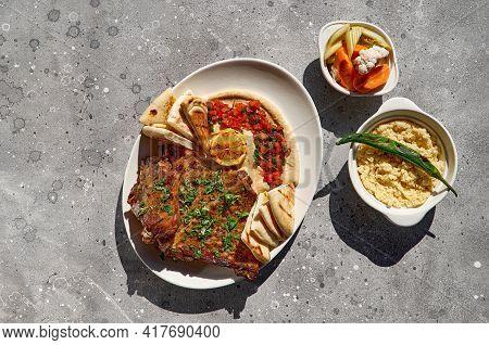 Delicious Rack Of Lamb With Hummus Sauce, Traditional Arabic, Turkish, Israeli Cuisine. Roasted Lamb