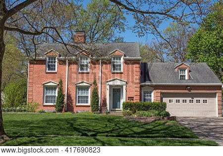 Red Brick Georgian Colonial House with Three Dormers