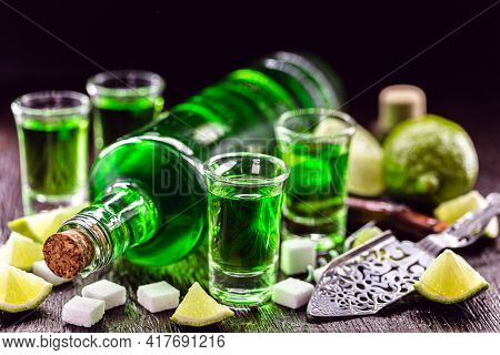 Doses Of Absinthe With Brown Sugar Cubes. Distillate Of Absinthe In A Glass And Lemon, Stainless Ste