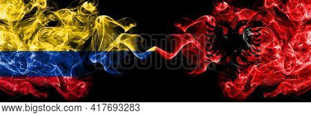 Colombia, Colombian Vs Albania, Albanian Smoky Mystic Flags Placed Side By Side. Thick Colored Silky