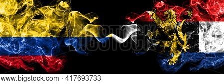 Colombia, Colombian Vs Benelux Smoky Mystic Flags Placed Side By Side. Thick Colored Silky Abstract