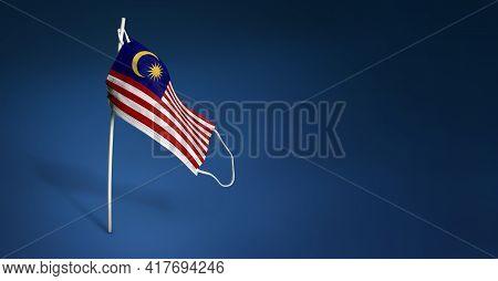 Malaysia Mask On Dark Blue Background. Waving Flag Of Malaysia Painted On Medical Mask On Pole. Conc
