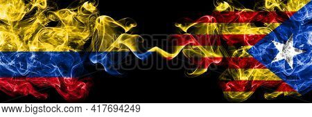 Colombia, Colombian Vs Catalonia, Catalan, Catalonian, Spain Smoky Mystic Flags Placed Side By Side.