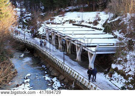 Slanic Moldova, Bacau, Romania - February 21, 2021: People Walking At Mineral Water Springsin Slanic